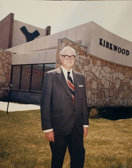 Robert Kirkwood stands in front of Kirkwood Plaza, 1971